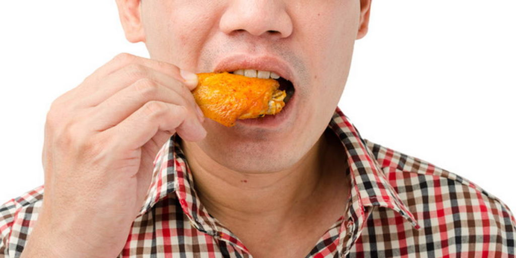 How To Eat Wings Without Looking Like A Neanderthal On Your First Date